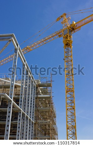 Highrise Construction Site and Tower Crane - stock photo