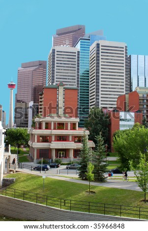 Highrise office and apartment buildings in Calgary, Alberta, Canada with greenery and Buddhist temple in the foreground and the Calgary tower in the background - stock photo