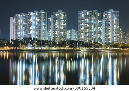 highrise Residential building in Hong Kong city at night - stock photo