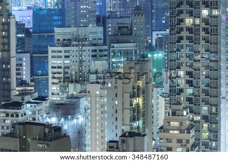 highrise residential buildings in Hong Kong city at night - stock photo