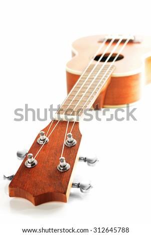 Hight key picture of wooden ukulele  - stock photo