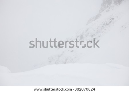 Hight tatra mountain Storm. Winter ascent of the mountain in the snow storm (blizzard). High tatra - stock photo