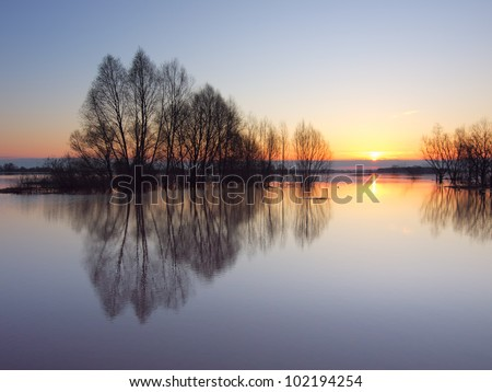 Hight water river on Sunrise. Spring at Oka river in Russia