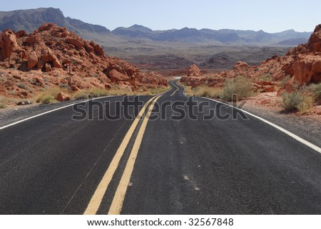 Highway across the Valley of Fire State Park near Las Vegas, Nevada - stock photo