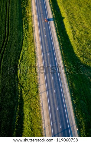 Highway - aerial landscape of autumn in Lithuania - stock photo