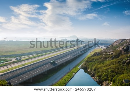 highway against a blue sky, road to the container terminal