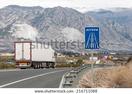 Highway and signs among mountains near Granada, Spain - stock photo