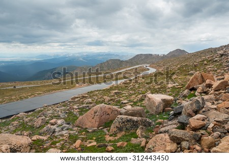 Highway ascending to the summit of Mount Evans in Colorado. - stock photo
