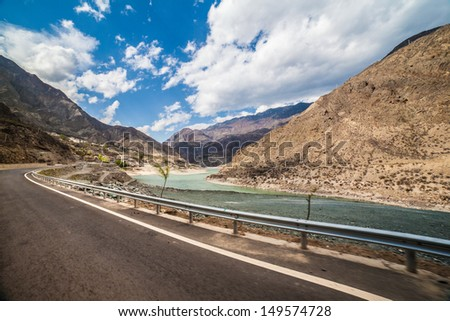 Highway beside the river - stock photo