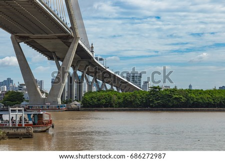 Highway Bhumibhol bridge across Chaopraya river of Bangkok Thailand in sunny day, famous public landmark of Thailand