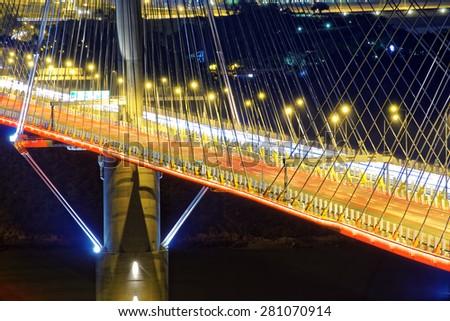 highway bridge at night with traces of light traffic, Ting Kau bridge at hong kong. - stock photo