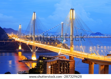 highway bridge at night with traces of light traffic, Ting Kau bridge at hong kong. - stock photo