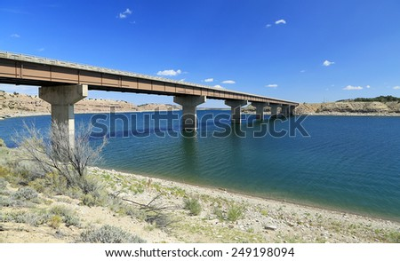 Highway bridge with blue sky and water, Utah, USA. - stock photo