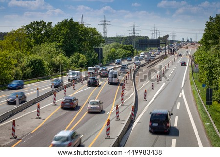 Highway construction site with constrictions and different lanes - stock photo