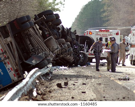 Highway crash wreck with truck, and rescue workers - stock photo