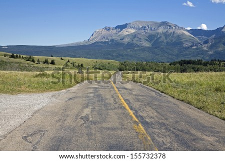 Highway cross national park with mountain background - stock photo