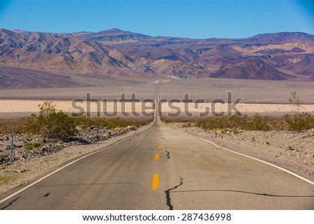 Highway 190 crossing Panamint Valley in Death Valley National Park - stock photo