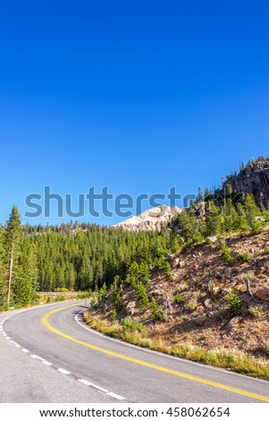 Highway curving through Shoshone National Forest in Wyoming, USA - stock photo