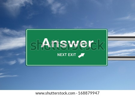Highway exit sign for Answer direction with blue sky on the background