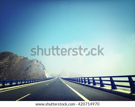Highway going through the mountains. Andalusia, Spain. - stock photo