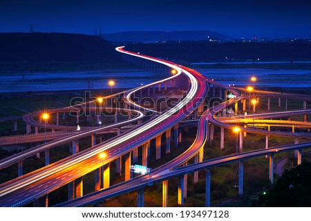Highway in night with cars light in Taiwan - stock photo