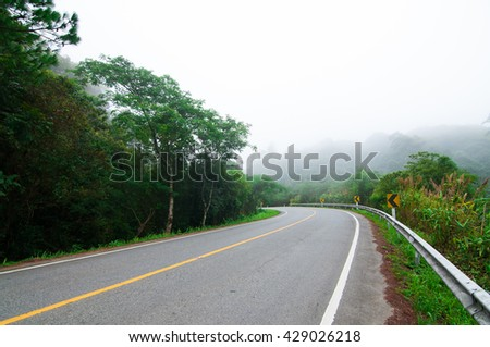 Highway in  the mist.Doi Inthanon.Chiangmai.Thailand