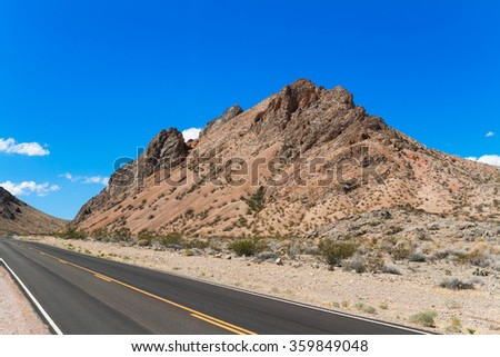 Highway in Valley of Fire State Park, South Nevada, USA - stock photo