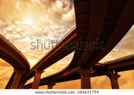 Highway interchange, warm toned - stock photo