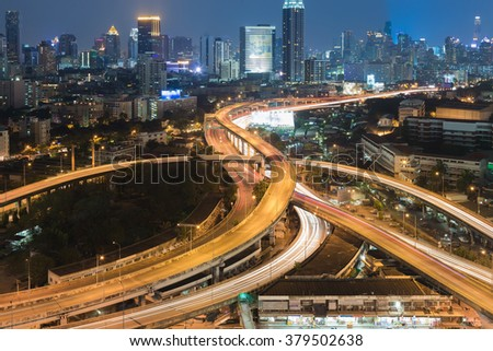Highway interchanged with city downtown night view - stock photo