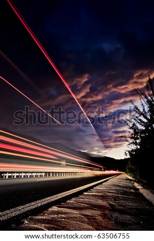 Highway Light Trails Long Exposure Portrait Orientation - stock photo