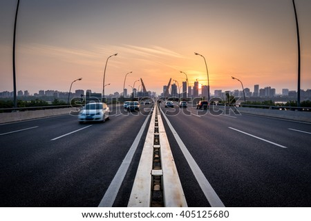 Highway overpass motion blur with coast skyline background . - stock photo