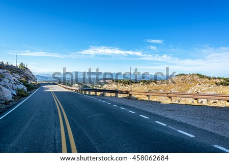 Highway passing through the Beartooth Mountains in Montana - stock photo