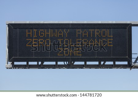 Highway Patrol zero tolerance zone electric warning sign. - stock photo
