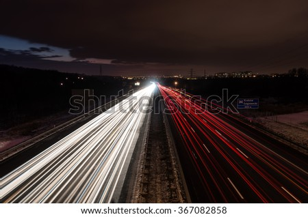 highway red and white car light trails - stock photo