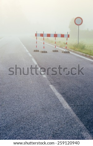 Highway road blurring in the fog. Road signs.  - stock photo