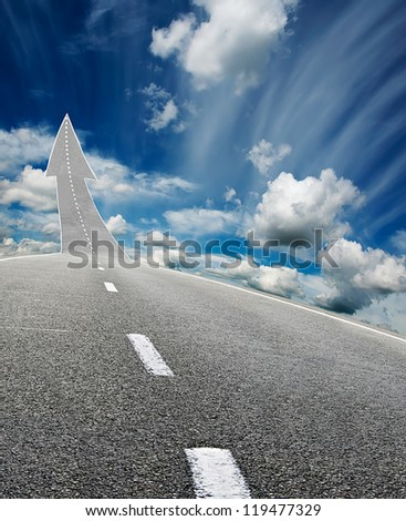 highway road going up as an arrow over blue cloudy  sky