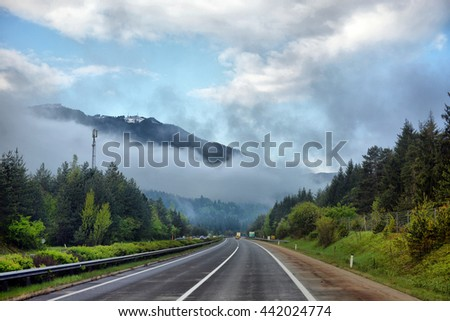 Highway road in the mountains - stock photo