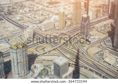 Highway road intersection in Dubai, sunny day, tilt-shift shooting - stock photo