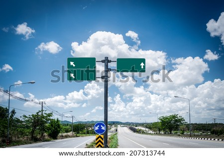 Highway road sign and blue sky with clouds - stock photo