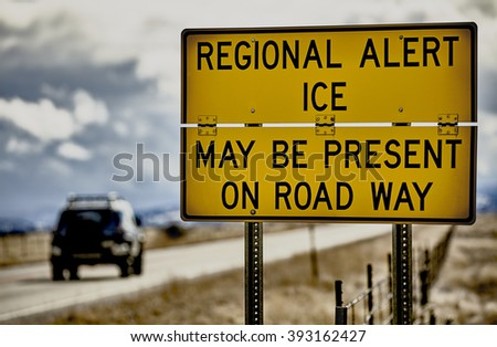 Highway road sign ice alert winter storm car truck danger