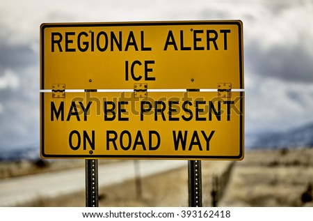 Highway road sign ice alert winter storm car truck danger hazard