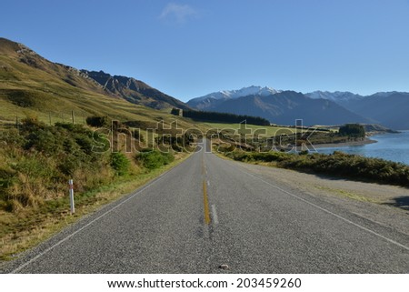 Highway Road streching to the mountains, South island, New Zealand. - stock photo
