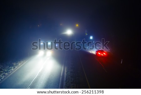 Highway road with traffic at night (toned, diffused). Light effects in fog.  - stock photo