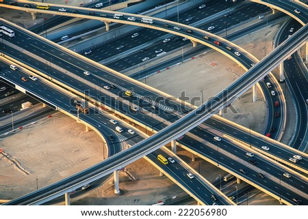 Highway roads with traffic in a big city (Dubai) at sunset. Transportation concept. - stock photo
