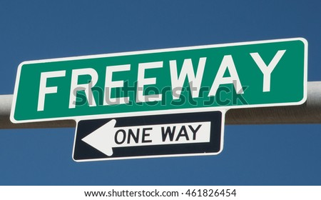 "Highway sign ""freeway one way"""