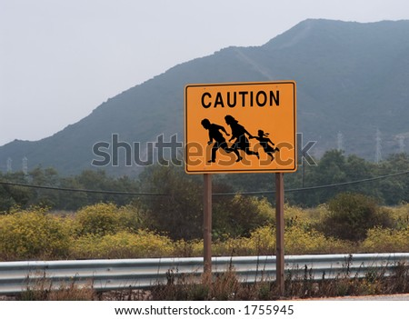highway sign showing family crossing - stock photo