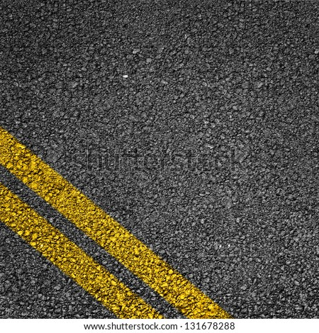 Highway surface with two yellow lines. Asphalt backdrop