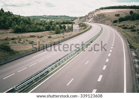 Highway through France at summer time. Top view