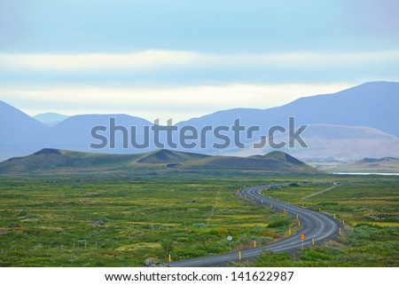 Highway through Iceland landscape at foggy day. Horizontal shot