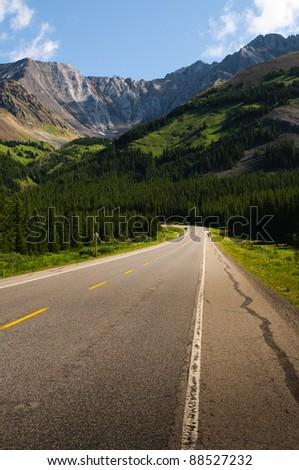 Highway through the Alberta Foothills - stock photo